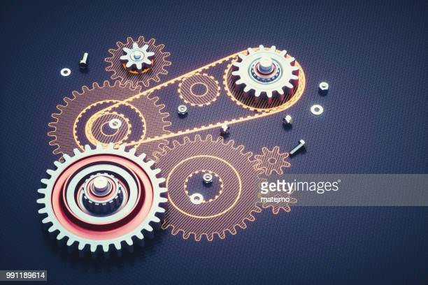 disassembled machinery featuring gears and artificial schematics - gearshift stock photos and pictures
