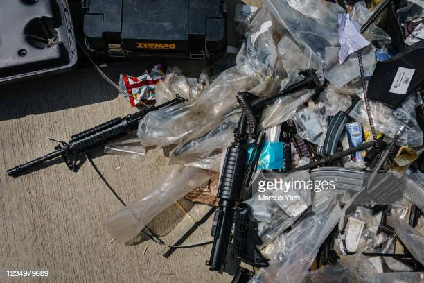 Disassembled parts of rifles sit in a trash pile after Taliban fighters seized the Hamid Karzai International Airport, in the wake of the American...