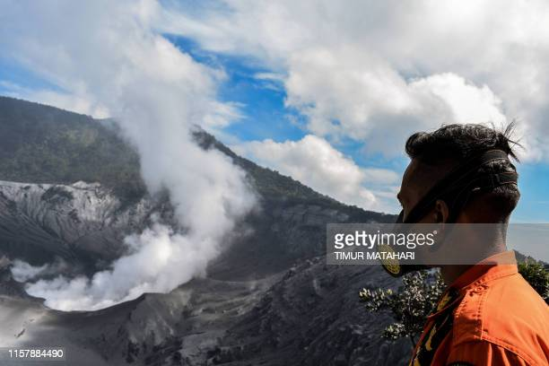 TOPSHOT A disaster agency official visits the Tangkuban Perahu volcano near the city of Subang in West Bandung regency West Java province on July 27...