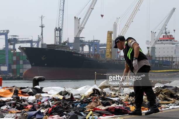 Disaster Victim Identification officials check the items during the evacuation process of Lion Air JT 610 aircraft which crashed into Karawang sea at...