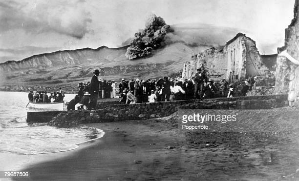 1902 This picture shows the last boats taking people evacuating from St Pierre under the volcanic cloud of Mount Pelee The erupting volcano Mount...