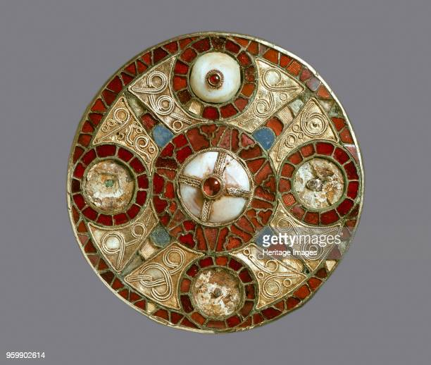 Disc brooch 7th century AngloSaxon jewelled disc brooch two of the originally five domed shell elements are still preserved with their garnets the...
