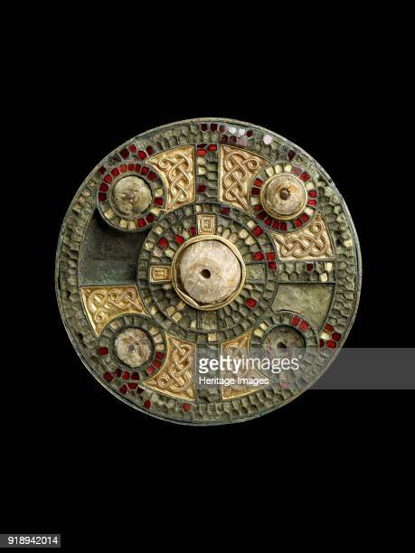 Disc brooch AngloSaxon Period Silver circular disc brooch cloisonne decoration of garnets Dimensions diameter 74 cmthickness 11 cm Artist Unknown