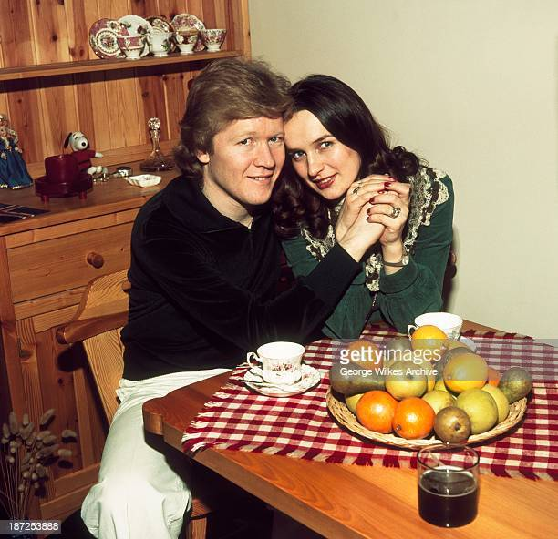 Disc jockey and TV broadcaster David 'Kid' Jensen photographed at home with his wife Gudrun. During his career Jensen has presented Top Of The Pops...