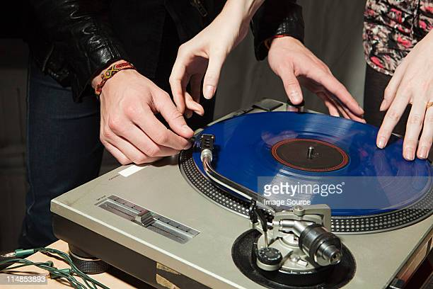 Disc jockey at party on mixing desk