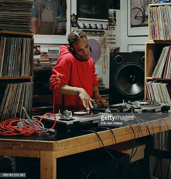 disc jockey playing record - hip hop music stock pictures, royalty-free photos & images