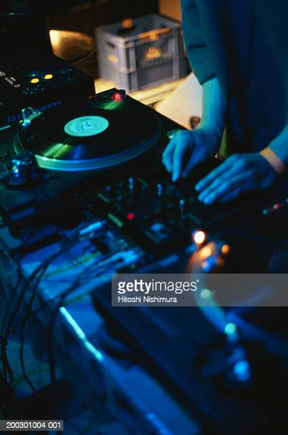 Disc jockey playing records, mid section