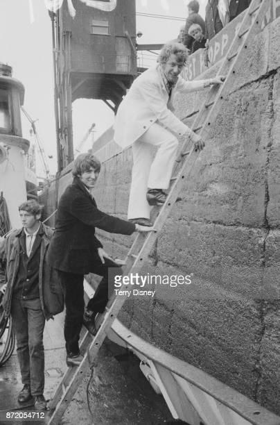 Disc jockeys Robbie Dale and Johnnie Walker of offshore pirate radio 'Radio Caroline' arrive at Felixstowe UK 15th August 1967