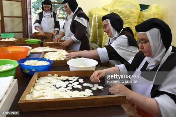 Discalced Carmelites nuns make hosts in preparation for the visit of Pope Francis to the country next July 10 to 12, at their nunnery in Asuncion, on...