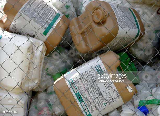 Discarded agrochemical cans are seen at a depot near Gualeguaychu Entre Rios province Argentina on February 7 2018 Soybean fields in Argentina are...