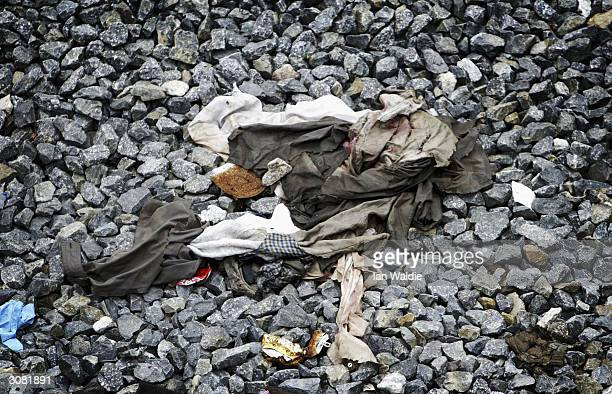 Discarded and bloodied clothes lie near the train tracks at Atocha train station March 13 2004 in Madrid Ten bombs exploded March 11 killing 200...