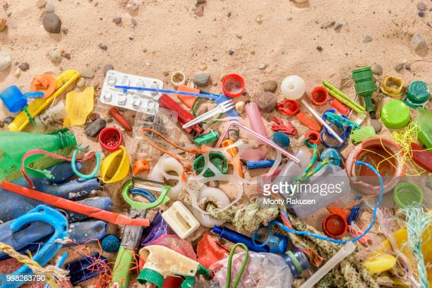 discarded and polluting plastic garbage on sand collected from beach in north east england, uk - plastic stockfoto's en -beelden