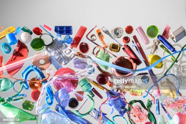 discarded and polluting plastics collected from beach in north east england, uk - plástico - fotografias e filmes do acervo