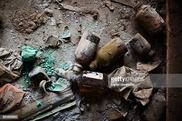 Discarded bottles of chemicals lay on the floor in a building at the site of the deserted Union Carbide factory on November 28 2009 in Bhopal India...