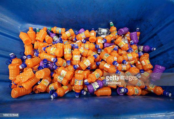 Discarded bottles of Robinsons Fruit Shoot drinks produced by Britvic Plc sit in a recycling bin at the company's factory in Norwich UK on Tuesday...