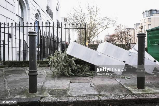 A discarded Christmas tree is seen under a bed in Angel on January 5 2018 in London England In the lead up to Christmas a pine tree is the centre...