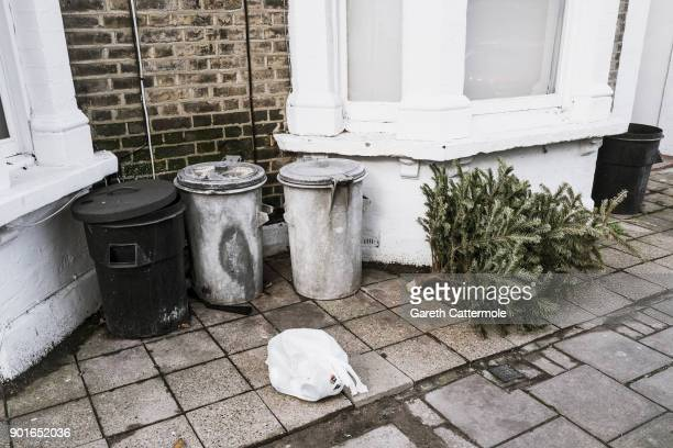 A discarded Christmas tree lies in a street in Angel on January 5 2018 in London England In the lead up to Christmas a pine tree is the centre point...