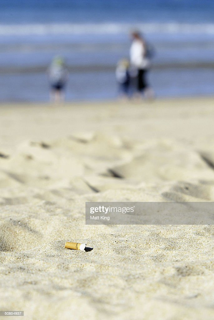 A discarded cigarette butt lies on Manly Beach May 19, 2004 in Sydney, Australia. Waverley Council has passed a motion to investigate the legalities and enforcement of a smoking ban on the Council's beaches, including Bondi, after Manly Council recently outlawed smoking on beaches, making it the first place in the world outside Los Angeles to do so. Data from Clean Up Australia showed 32 billion cigarette butts were dropped in Australia each year, and that at any given time there were 700,000 on Bondi Beach.