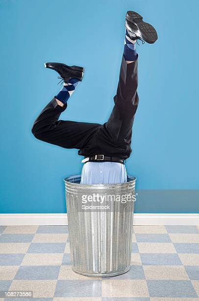 Discarded Corporate Executive In Trash Can