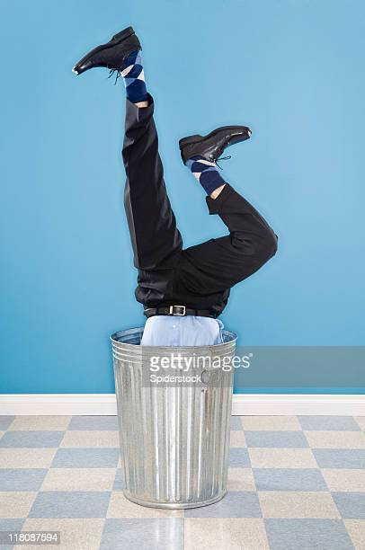 discarded corporate executive in trash can - being fired stock photos and pictures