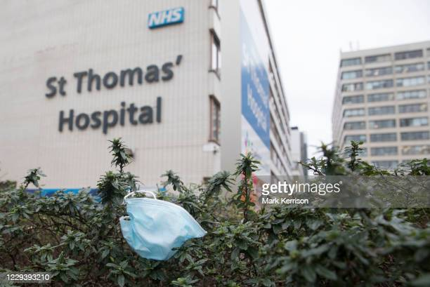 Discarded disposable face covering of the type used to help prevent the spread of the coronavirus is pictured in front of St Thomas Hospital on 30...