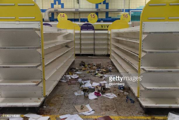 Discarded food containers and debris lays on the ground at the Centro 99 supermarket after looting in Maracaibo Zulia state Venezuela on Thursday...