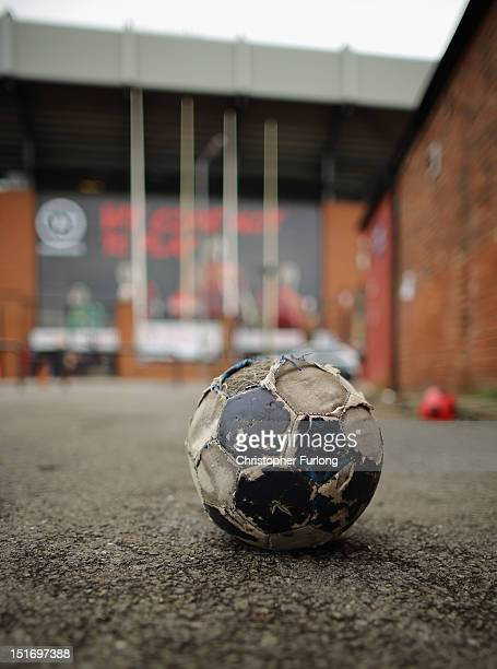 Discarded football sits on the floor outside Anfield Stadium, the home of Liverpool Football Club on September 10, 2012 in Liverpool, England. On...
