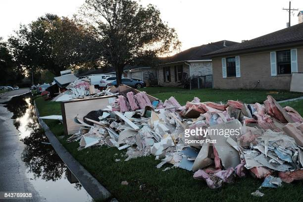 Discarded furniture and other household items sit on the curb outside of a flooded home in Orange as Texas slowly moves toward recovery from the...