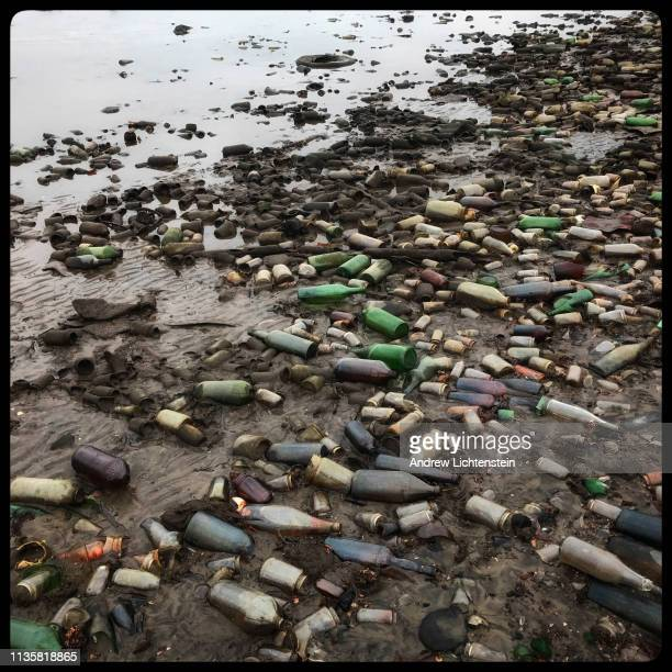 Discarded glass bottles left behind from an old municipal trash dump litter glass bottle beach on the edge of Dead Horse Bay on January 9 2019 in...