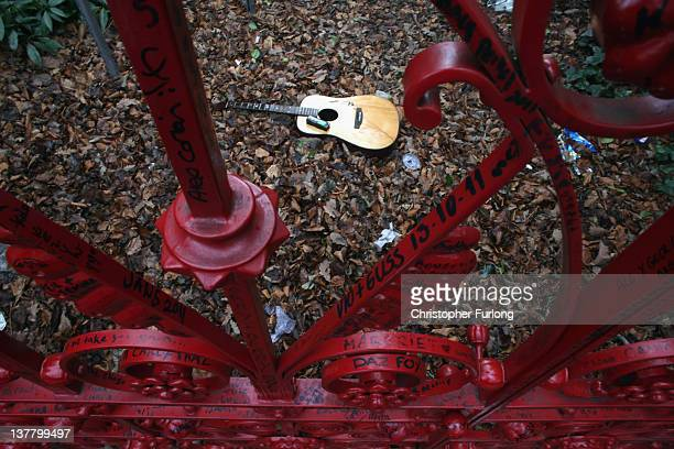 A discarded guitar lays behind the gates of the former Salvation Army orphanage Strawberry Field immortalised by the Beatles song 'Strawberry Fields...
