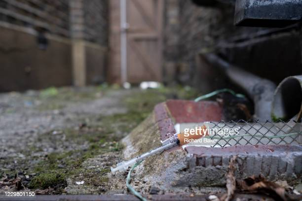 Discarded insulin syringe lies on the ground near a drain in a residential alleyway, on 25th November 2020, in London,England. Accorind to the NHS...