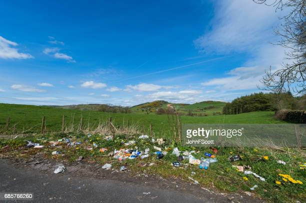 Discarded litter at the side of a rural road in Scotland