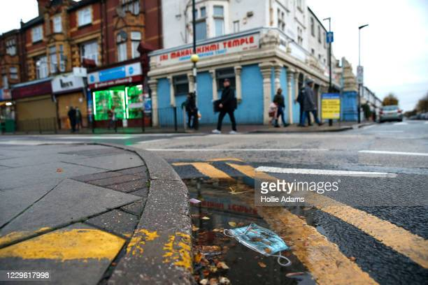 Discarded mask lies in the gutter on the high street opposite Sri Mahalakshmi Temple on November 14, 2020 in London, England. Diwali, the five-day...
