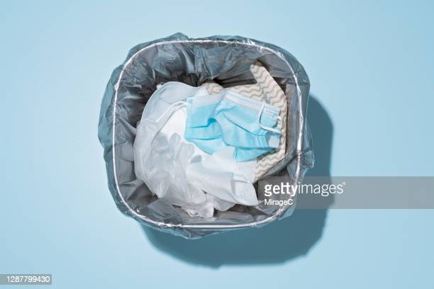 discarded masks, gloves and wet wipes in trash - rubbish bin stock pictures, royalty-free photos & images