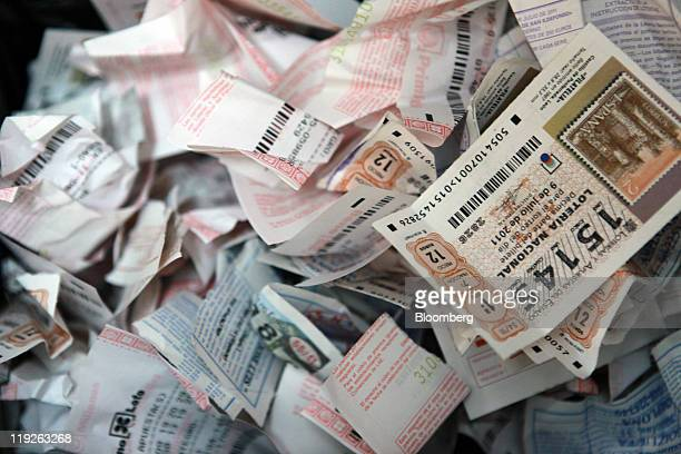 Discarded national lottery tickets sit in a bin at a store operated by Sociedad Estatal Loterias Apuestas del Estado Spain's stateowned lottery in...