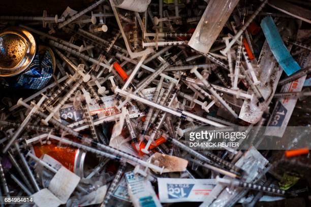 Discarded needles are seen at a heroin encampment in the Kensington neighborhood of Philadelphia Pennsylvania on April 7 2017 In North Philadelphia...