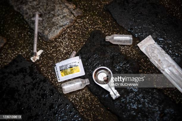 Discarded paraphernalia used by drug users is pictured in a lane in Glasgow on December 15 as the latest Scottish drug-related death figures were...