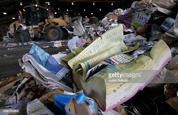 A discarded phone book sits in a pile of recyclables at the Recology recycling center on February 1 2011 in San Francisco California San Francisco...