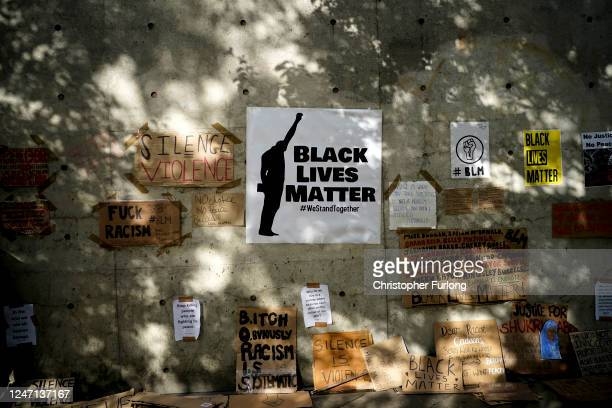 Discarded placards adorn a wall in Piccadilly Gardens after a Black Lives Matter demonstrations on June 06, 2020 in Manchester, United Kingdom. The...