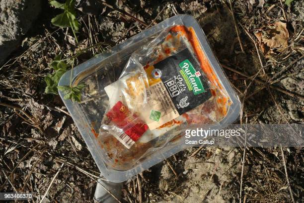 Discarded plastic food packaging lies on a beach along the Spree River in the city center on May 29 2018 in Berlin Germany Europe is struggling to...