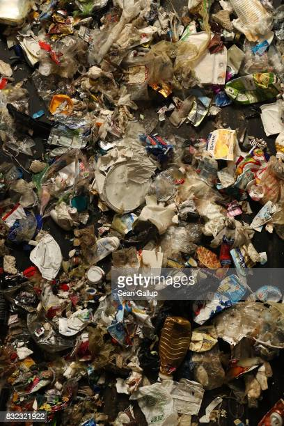Discarded plastics and other materials flow by on a conveyor at the ALBA sorting center for the recycling of packaging materials on August 15 2017 in...