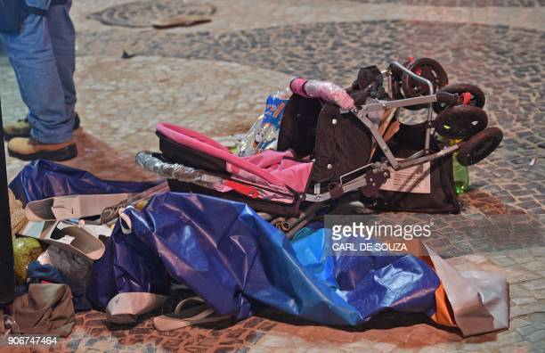 A discarded pram is seen at the scene of a car crash at Copacabana beach in Rio de Janeiro on January 18 2018 At least 11 people were injured by a...