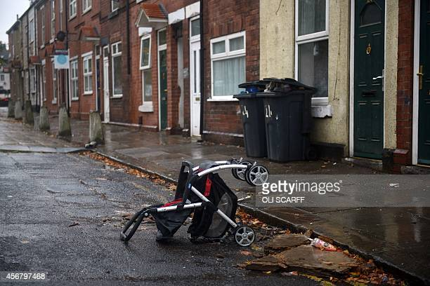 A discarded pushchair lies in the street in the Eastwood area of Rotherham South Yorkshire North England on October 6 2014 An inquiry revealed on...