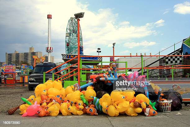 CONTENT] Discarded rubber ducks and balloons at the amusement park Coney Island Brooklyn New York