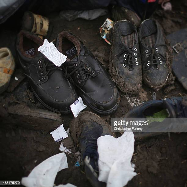 Discarded shoes lay on the ground as migrants discard items no longer wanted or needed when they cross the Hungarian border on September 14 2015 in...