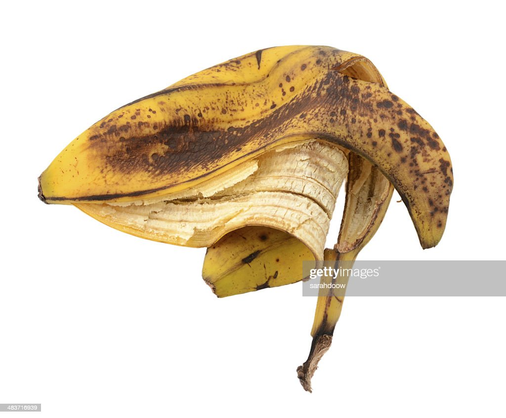 Discarded spotted overripe banana skin : Stock Photo