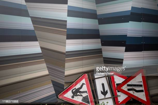 Discarded traffic signs lie in a corner of a construction hoarding at Nine Elms, south London, currently the largest construction site in Europe...
