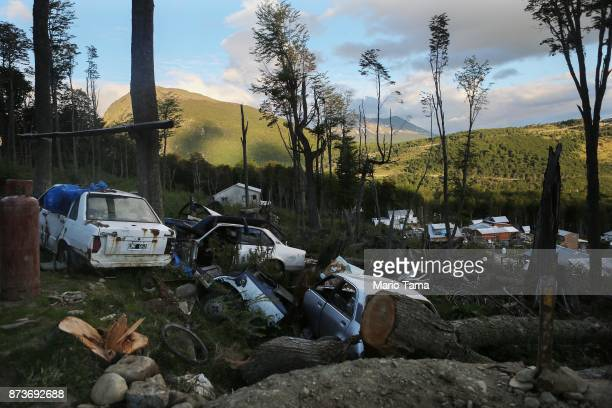 Discarded vehicles sit on the mountainside near an informal settlement on November 10 2017 in Ushuaia Argentina Many Ushuaians have constructed homes...