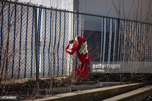 Discarded work clothes behind a liquor store on April 25th 2015 in downtown Fort McMurray Canada Fort McMurray is currently coping with an economic...