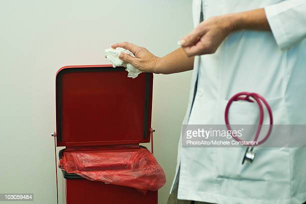 discarding waste in medical waste bin - toxic waste stock pictures, royalty-free photos & images